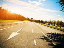 Going ahead empty pastoral asphalt way Royalty Free Stock Images