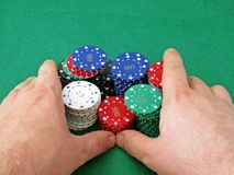 Going all in with stack of poker chips Stock Photos