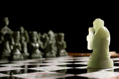 Going it Alone. One chess pawn facing the opposing side alone Royalty Free Stock Photos