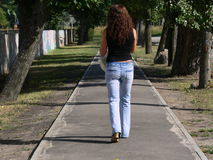 Going away. Young woman going away Royalty Free Stock Photo