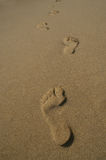 Going away. Footprints on the beach, Sardinia, Italy Stock Image