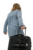 Going Away. A young girl pulling a suitcase, isolated against a white background Stock Photos