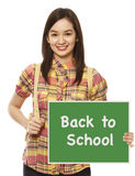 Going Back To School. A university student holding a Back To School signboard Stock Photography