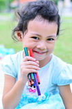 Going back to school : girl holding color pens Stock Photography