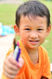 Going back to school : little boy holding color pens Stock Photo