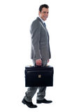 Going business man holding briefcase Stock Photography