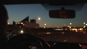Driving a car in a big city at night. Night lights. Going by car downtown at night stock video