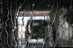 Going through car wash. Water streaked windshield in car wash Royalty Free Stock Image