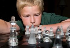 Going for check mate. Boy concentrating on his next chess move Royalty Free Stock Image