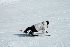Going Down. Girl faling on her snowboard Stock Photo