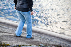 Walking carefuly. Going down an angled river shore is always something to be done carefully. Sliding down in the freezing water will not be a happy moment Royalty Free Stock Image