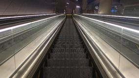 Going Down. On an escalator at an airport stock footage