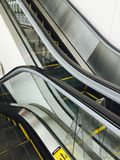 Going down. Escalators detail movement Stock Photo