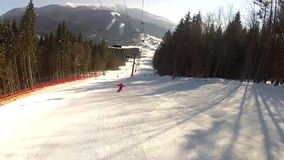 Going down the ski run in Bukovel stock video