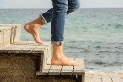 Down the stairs to the beach. Going down the stairs on the beach with bare feet down the stairs on the beach with bare feet Royalty Free Stock Photography