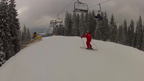 Going down the track past the ski lifts in Bukovel stock footage