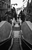 Going downhill. Black and white outdoor escalator going up the hill in the city of Barcelona Royalty Free Stock Photography