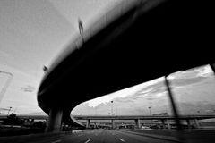 Going fast on highway, black and white. Speeding on a clear highway Bangkok Thailand Stock Photos