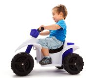 Going fast with quad. Little boy going fast with a little toy quad Stock Images