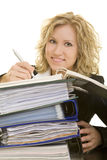 Going the files. Blonde business woman working on a stack of folders stock photos
