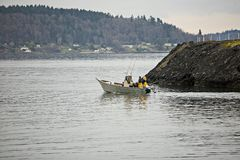 Going Fishing. Small craft going out into Puget Sound to do some fishing stock image