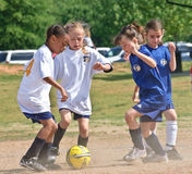 Going For The Ball/ Girl S Soccer Royalty Free Stock Photography