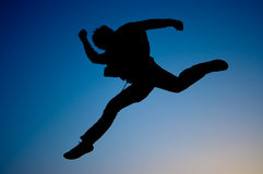 Going forward. Jump going forward, optimistic, and active person Royalty Free Stock Photo