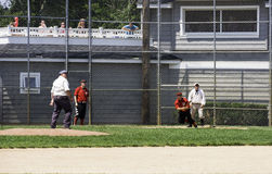 Going, Going, Gone... Spring Lake, NJ USA--July 11, 2015 Players and fans watch as a well-hit ball heads deep into left field in a baseball game played using Royalty Free Stock Photo