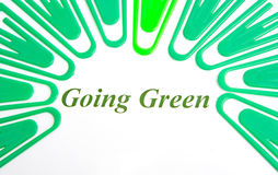 Going green; logo ?. An abstract image of green paper clips surrounding the words going green. The background is plain white royalty free illustration