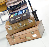 Going on holiday. Stack of three antique suitcases Stock Image