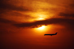 Going home. A airplane descent in sunset, it take people going home royalty free stock photography