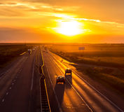 Going home. Cars on then highway at sunset royalty free stock images