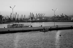Fishing boat arrives evening port Stock Images