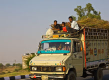 Going home on top of the Truck  India Stock Photo
