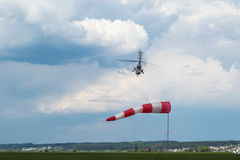 Going for landing helicopter Stock Images