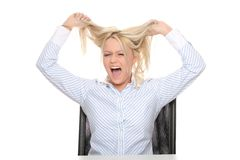 Going mad. Young businesswoman going mad - bankruptcy concept Royalty Free Stock Image
