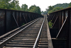 Going Off Track. Stay on track. Broken railroad bridge in White River Junction Vermont damaged by the flooding following tropical storm Irene royalty free stock photo