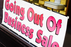 Going out of business. Sign in store window reading Going Out of Business Sale royalty free stock images