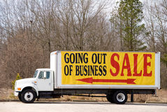 Going Out of Business. A truck advertising a store that is Going Out of Business Stock Photography