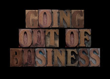 Going out of business. The words going out of business in old letterpress wood type Royalty Free Stock Photos
