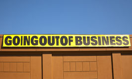 Going out of business. Sign on an building that has gone out of business Stock Image