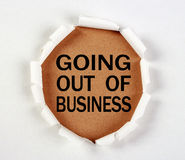 Going out of Business. Concept with white tear paper Stock Photography