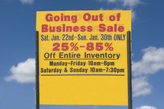 Going Out Of Business Sign. A sign advertises a business goes out of business with a blue sky background. Horizontal shot Royalty Free Stock Photos