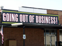 Going Out of Business Sign. Going out of business building with sign Stock Photography