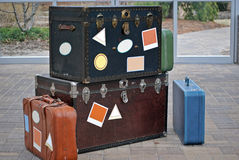 Going Places. Blank labels on steamer trunks and suitcases Stock Photo