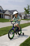 Going for a ride. A young boy enjoying riding his bike Royalty Free Stock Images