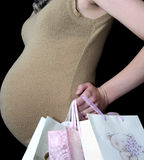 Going shopping. Pregnant woman shopping for newborn baby to be Stock Images