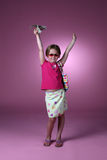 Going Shopping Woo Hoo. Cute girl holding money up in the air Royalty Free Stock Photography