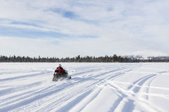 Going with snowmobile towards to mountain in Lapland Royalty Free Stock Photography