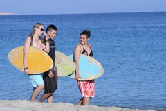 Going surfing. Happy young surfers going surfing Stock Image